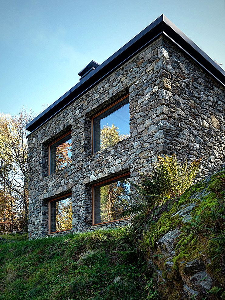 En Modern Mountain Cabin With A Rustic Stone Shell